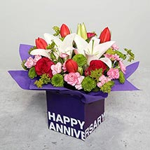 Tulips Roses and Carnations in Glass Vase:  Wedding Anniversary Gifts
